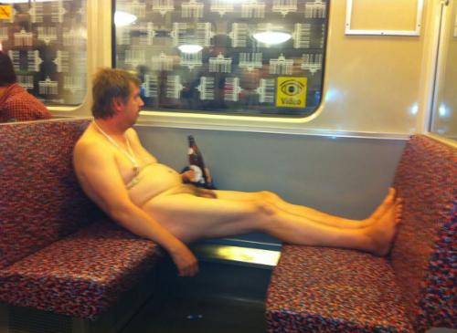Naked man drinking Sternburg on the U-Bahn.